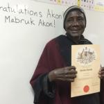 Akon holding Australian Citizenship certificate