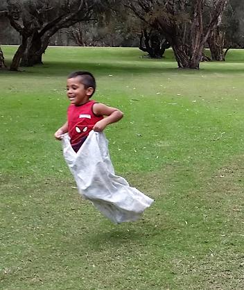Child enjoying sack race
